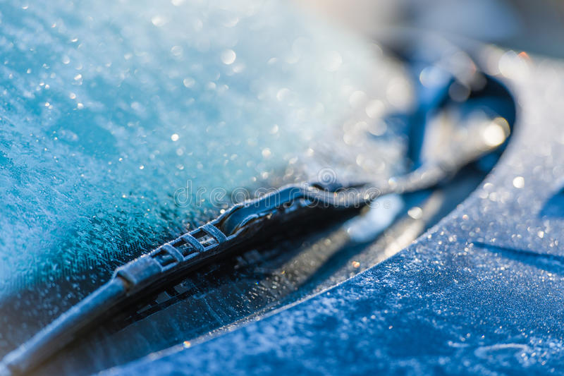 Frozen windshield. Cold weather, sunlight on back light, focus on foreground royalty free stock images