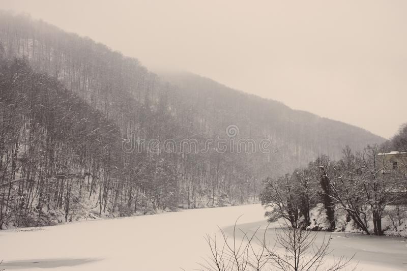 Frozen winter lake with cold forest in Lillafured, Miskolc, Hungary. Lake with ice and snowy mountain. Winter landscape. Travel in Hungary. Winter weather royalty free stock photo