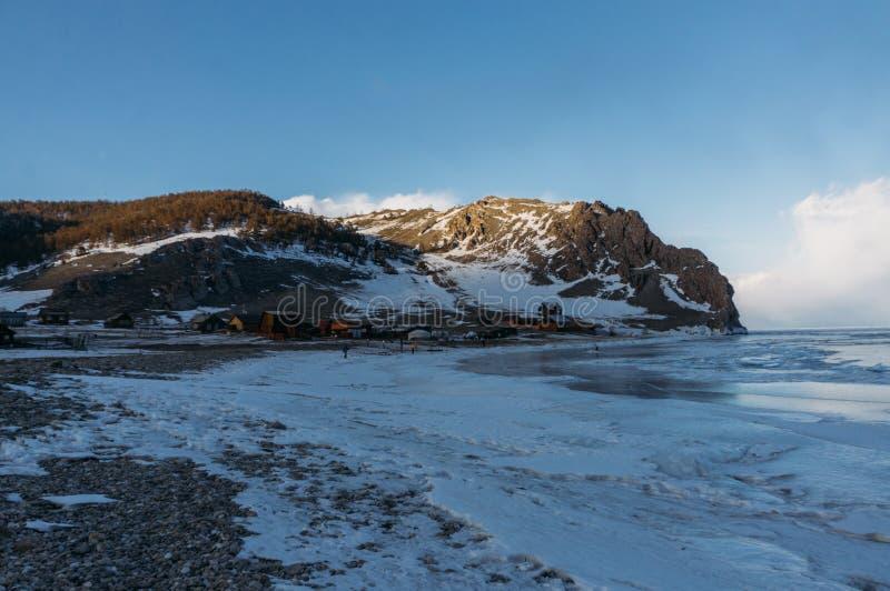 Frozen winter lake in scenic mountains, Russia,. Lake Baikal royalty free stock image