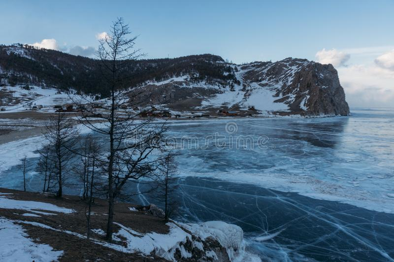 Frozen winter lake in scenic mountains, Russia,. Lake Baikal royalty free stock photo