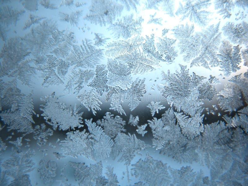 Frozen winter window. This is frosty pattern on glass winter window stock photo