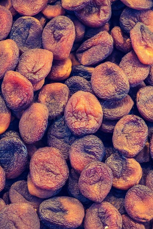 Frucht der getrockneten Aprikose als Hintergrundbeschaffenheit stockfotografie