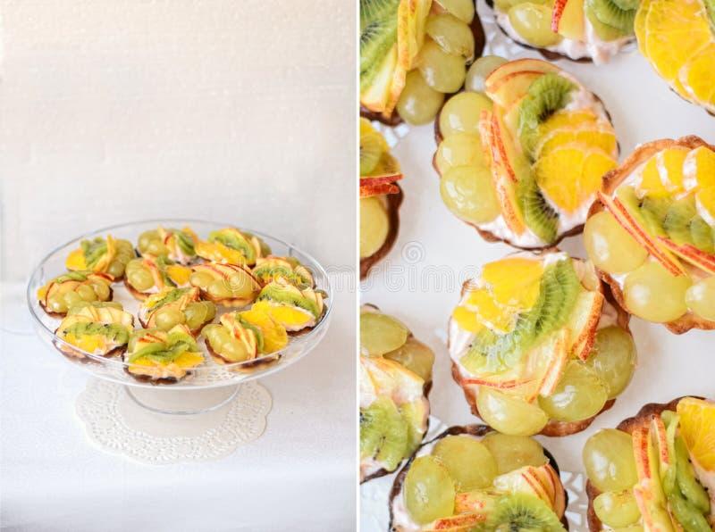 Fruchttortentörtchen mit Kiwi, Trauben, Orange und Apfel stockfotografie