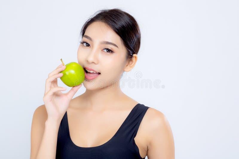 Frui verde de sorriso da maçã guardar e comer da mulher asiática do retrato fotos de stock royalty free