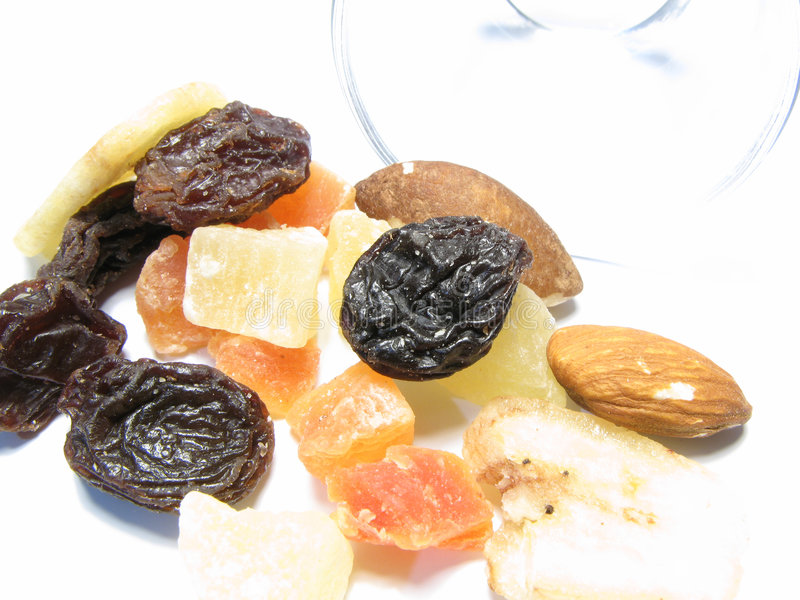 Fruit. Various dried fruit in a glass teacup on a white background stock photo