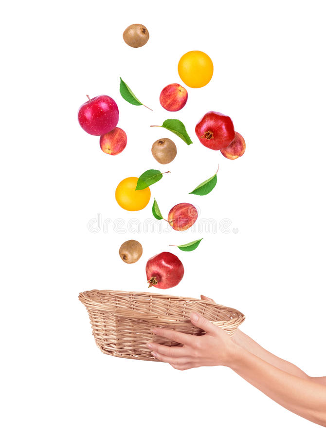 Fruit alling from basket royalty free stock photo