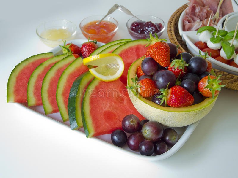 Fruit and antipasti royalty free stock photography