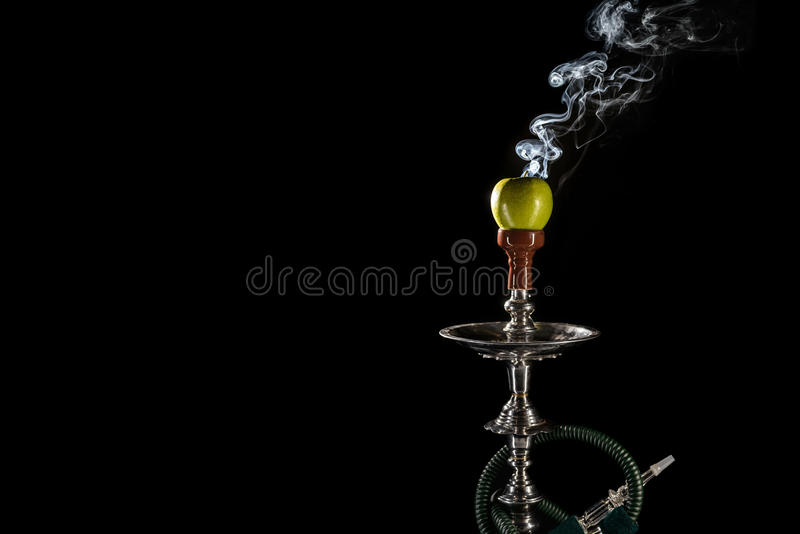 Fruit aroma hookah. Smoking hookah with fruit head on dark background stock images