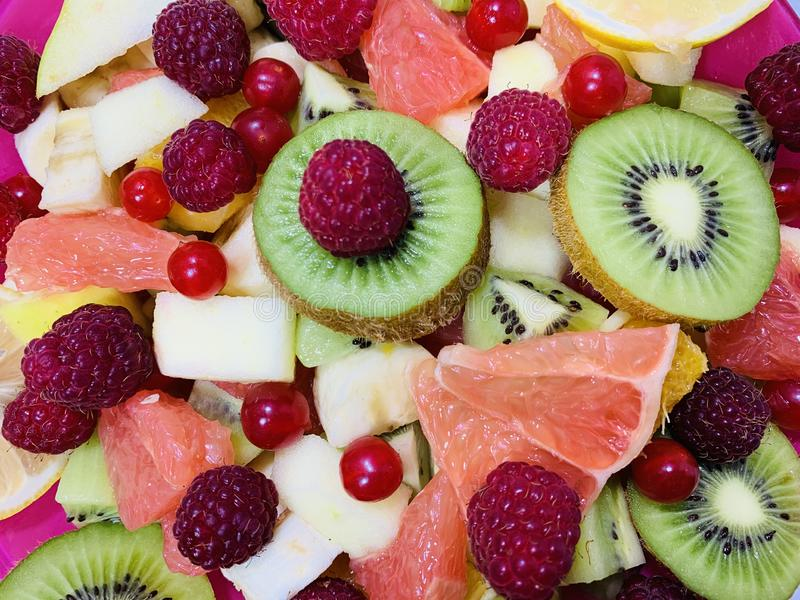 Fruit background photo.Fruit salad close-up. Variety of colorful fruits. Fruit platter. stock photos