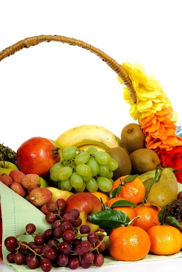 Fruit basket. Seasonal varied tropical fruit basket. Studio, white background stock photography