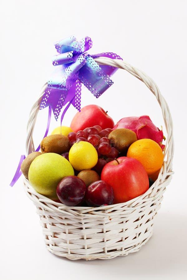 Fruit basket. Isolated on white stock image