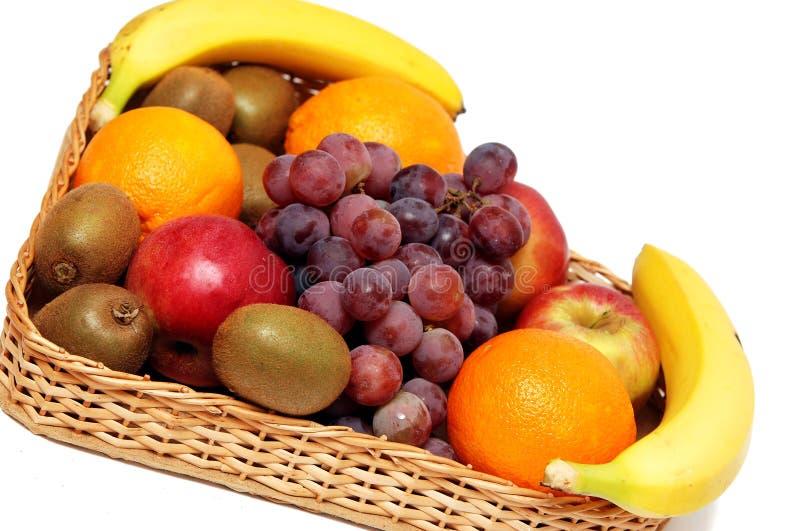 Fruit basket. On a white background royalty free stock photo