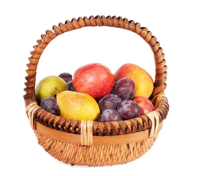 Fruit basket. Foto-fruit basket-apple, pear, peach, plum royalty free stock image