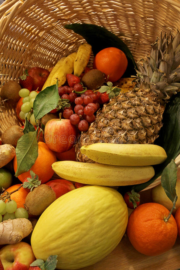 Fruit basket. Colorfull fruit basket with oranges, bananas, grape, apples and kiwi stock photos
