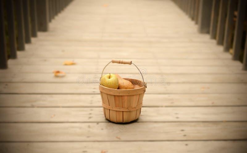 Fruit Basket. On a walkway royalty free stock photo