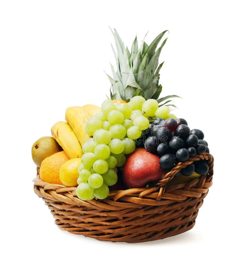 Fruit basket. With mixed fruit on white background stock photos