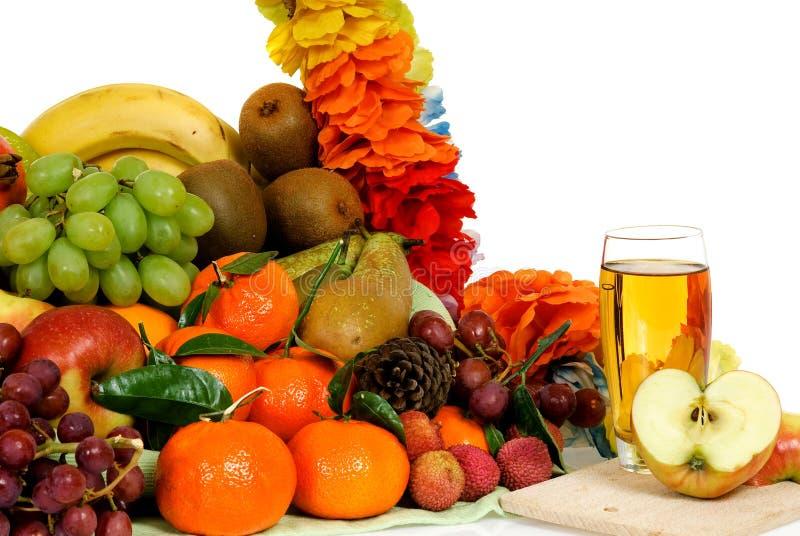 Fruit basket, apple juice royalty free stock images