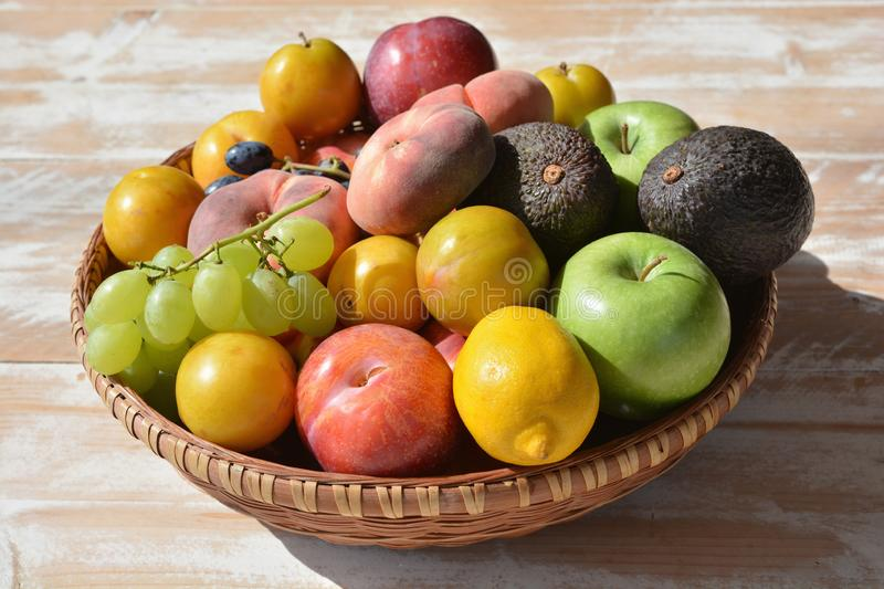 Healthy summer eating. Fruits piled high in a basket. stock photo