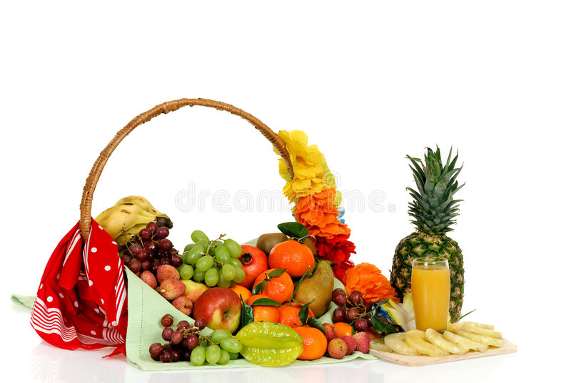 Fruit basket, pineapple juice royalty free stock photo