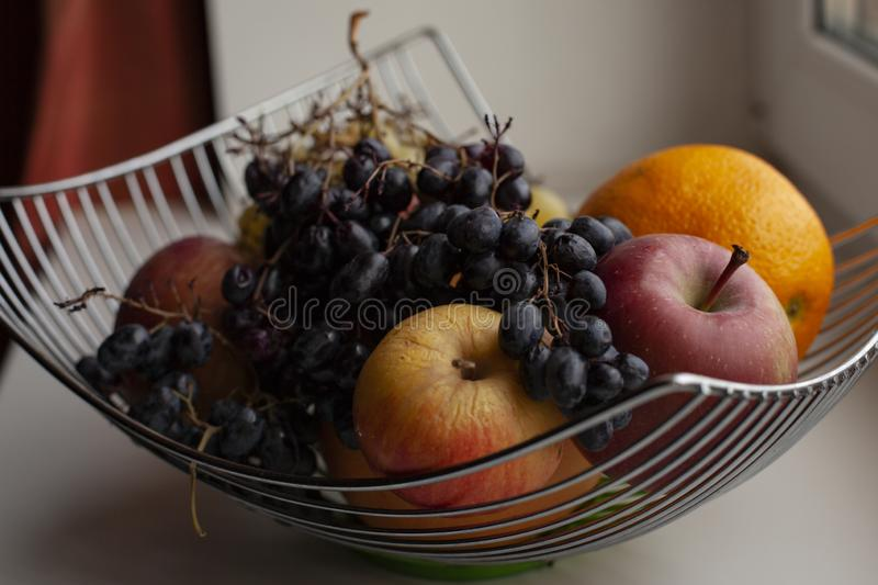 Fruit basket, vitamin cocktail, apples, grapes, and other fruits stock images