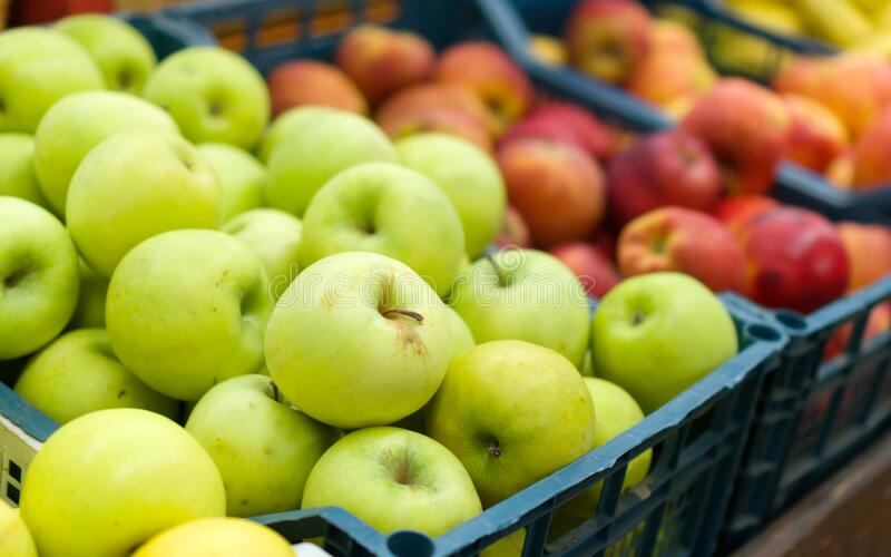 Red and green apples. Fruit baskets in the market. Red and green apples royalty free stock photo