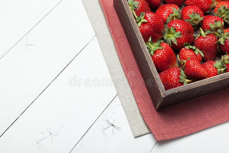Fruit bowl strawberry background, red natural berry on table.  royalty free stock photos