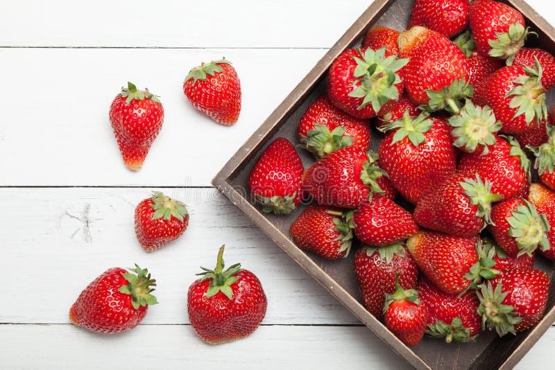 Fruit box or basket, fresh strawberry background.  royalty free stock images