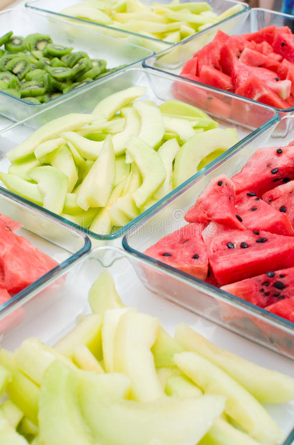 Fruit buffet. Summer fruit buffet with kiwis, watermelon and cantaloupe royalty free stock photos