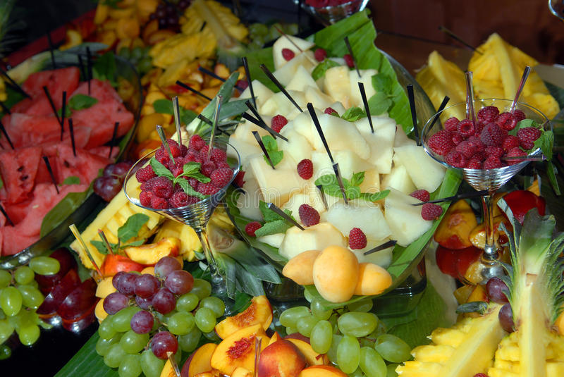 Fruit on a buffet table. The cut fruit on a buffet table royalty free stock image
