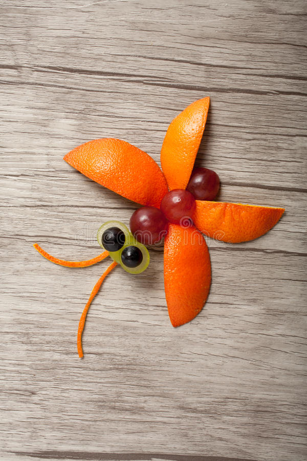 Fruit butterfly made on wood stock images