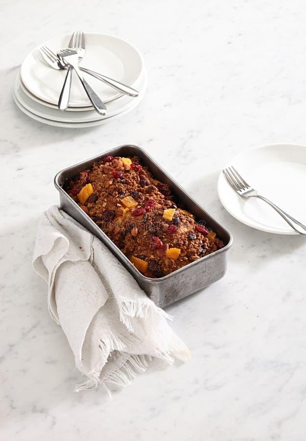 Fruit cake. In baking pan stock photos