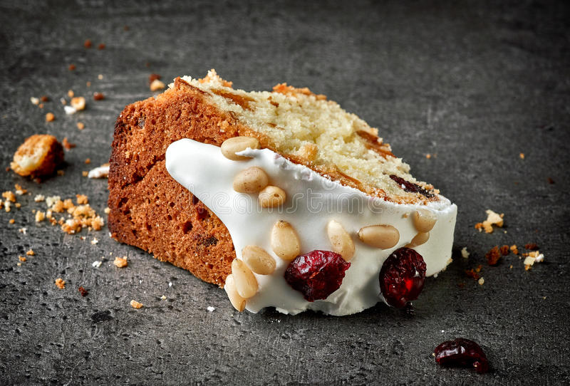 Fruit cake piece. On dark grey table royalty free stock photos