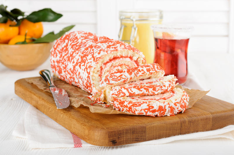 Fruit cake roll sliced on cutting board royalty free stock photo