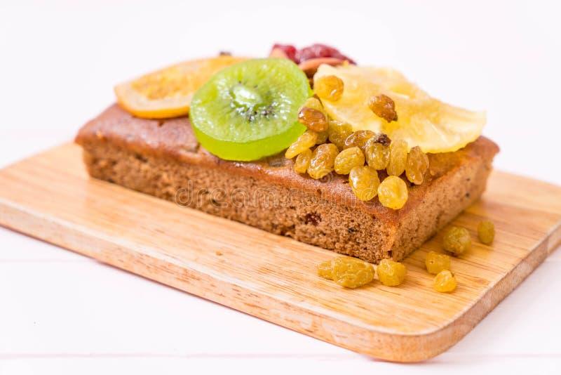 fruit cake on wood stock photos