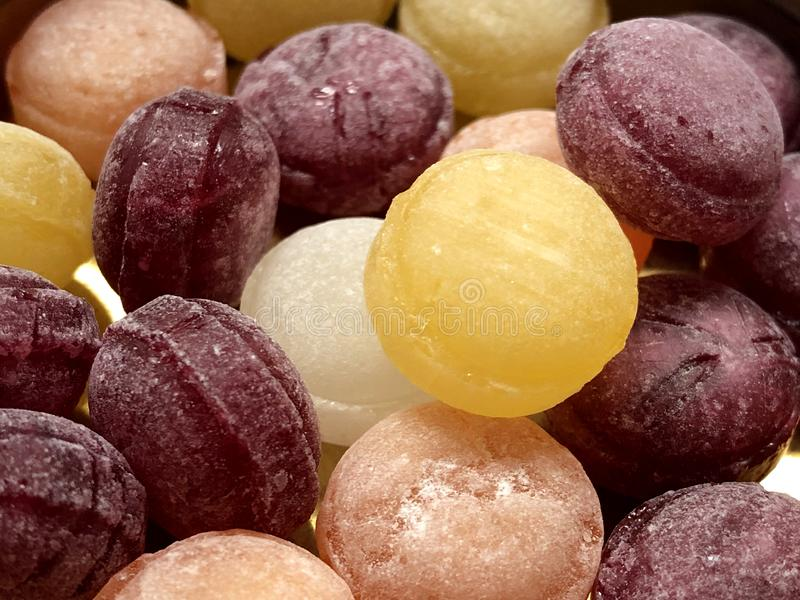 Multicolored round candies close-up on a white background. royalty free stock photography