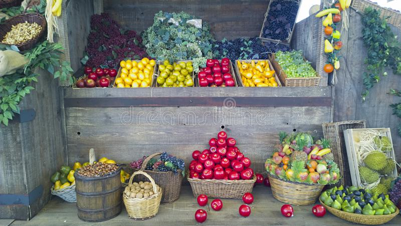 Fruit cases with colored rich tasteful different types of fruits and vegetable and baskets. Fruit cases with colored rich tasteful different types of fruits and royalty free stock photos
