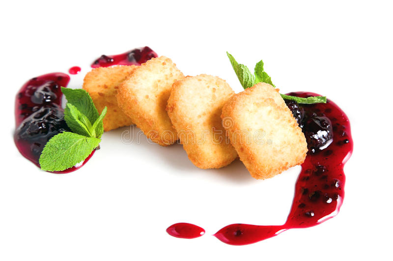 Fruit cheese with blackberry sauce royalty free stock photo