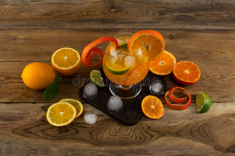 Fruit cocktail with ice on wooden table royalty free stock photos
