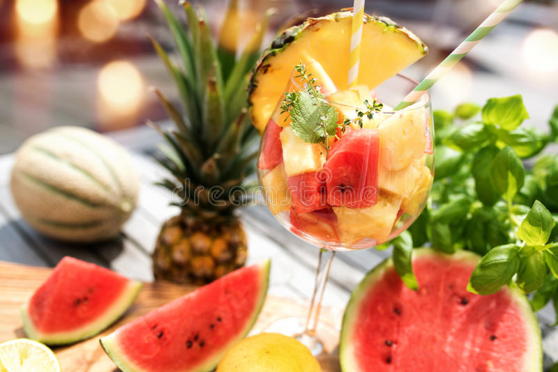 Fruit cocktail with melon and pineapple royalty free stock images