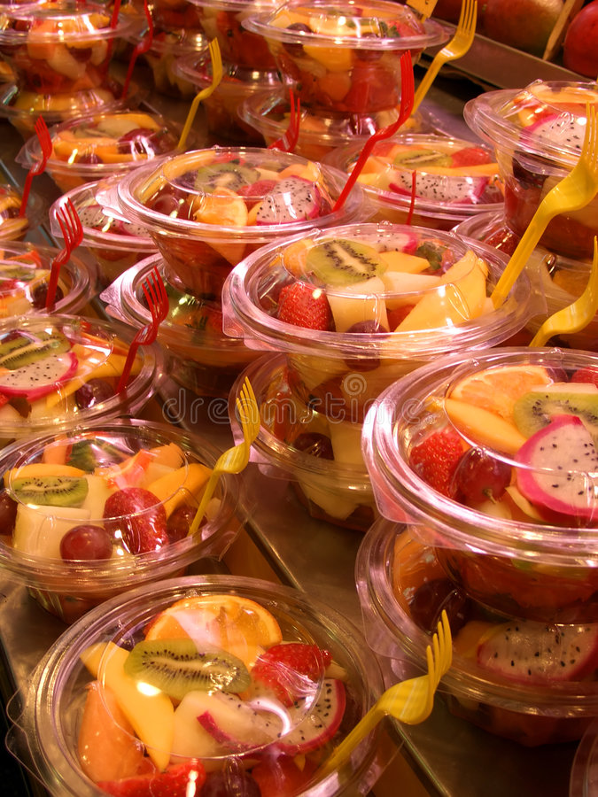 Fruit cocktail in plastic bowls, fruit market, Barcelona, Spain stock photography