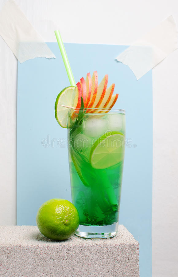 Fruit cold lemonade on a stone table royalty free stock photography