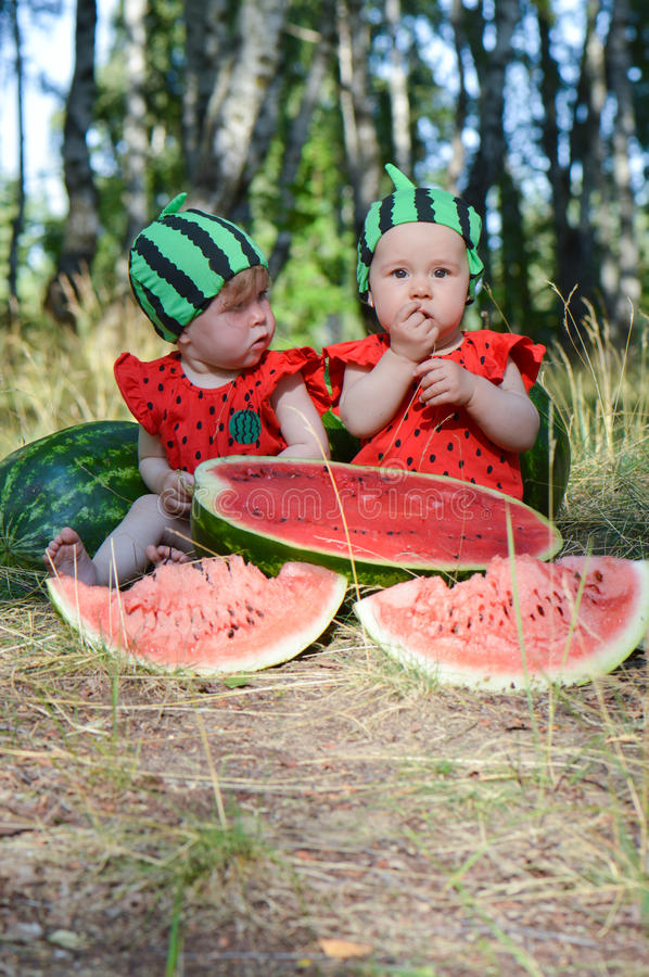 Fruit contrasts. Watermelon costumes kids eat watermelons