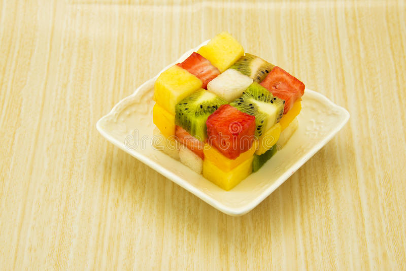 Fruit cube. The table is made with fruit with the Rubiks cube shape, very beautiful, very delicious stock image