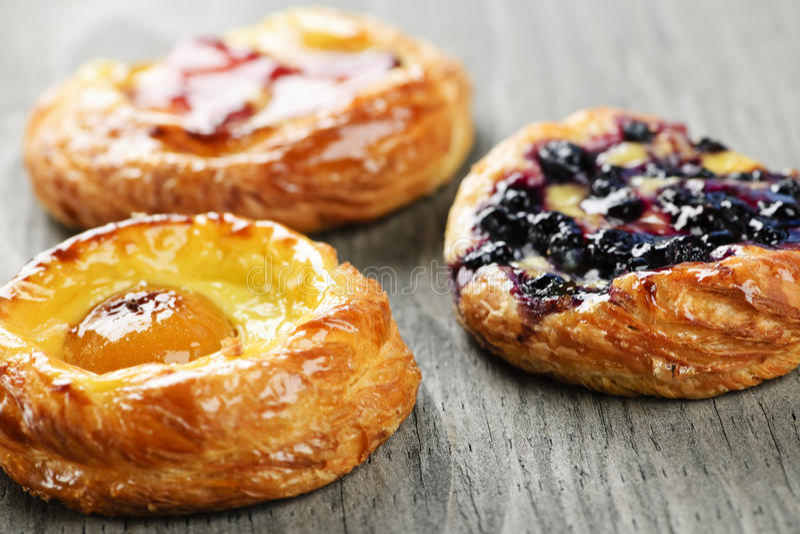 Fruit danishes. Closeup on three sweet fruit danish desserts stock image