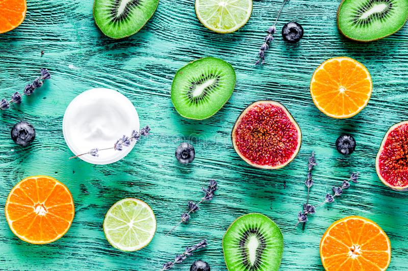 Fruit design on blue rustic desk background top view pattern royalty free stock images