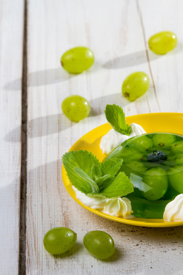 Fruit dessert with jelly and cream stock photo