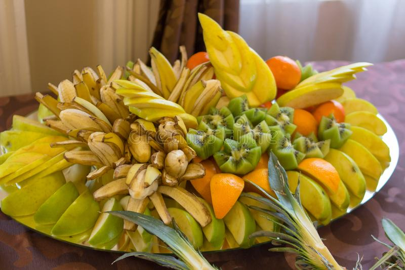 Fruit dessert restaurant,large plate with bananas and oranges and kiwi stock photo