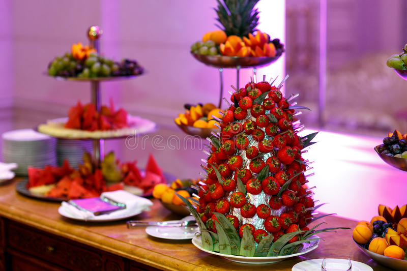 Fruit dessert. A set of delicious sweet desserts from a variety of fruit on a tray. Celebrating a wedding, birthday or other special event stock image