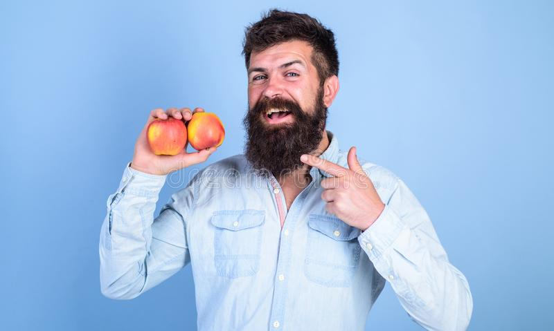Fruit dieting. Join healthy lifestyle. Man with beard hipster hold apple fruit hand. Nutrition facts and health benefits stock images