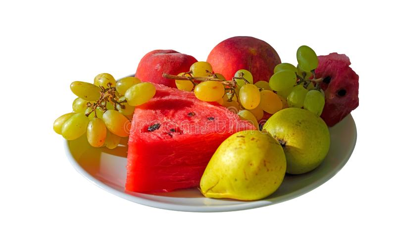 Fruit dish with water melon, grape, pear and peach in isolated white background stock photo
